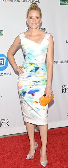 Elizabeth Banks wore a bright Roland Mouret frock with a neon splatter paint design. She styled the look with equally eye-catching holographic pumps and a bright orange clutch.