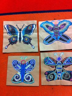 Blotto Butterfly with construction paper crayons and silver sharpie