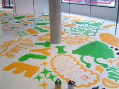 Oda. This is a floor painting by BOSQUE Estudio to decorate a local clothing shop.