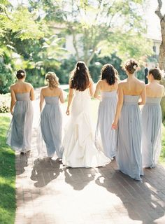 Pale blue bridesmaids' gowns by The Dessy Group