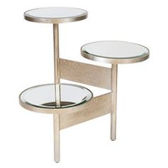 Worlds Away Colin Silver Leafed Side Table Mirrored Tops – $998.00 Three tiered circular tops heighten the transitional style of the Colin side table. Mixing beveled mirror surfaces with an adjustable silver base, this Worlds Away furnishing emits elegance in modern form. Silver leaf; Iron; Table is hinged; Depth and width are adjustable;