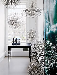 Dutch design collective Moooi highlights its Raimond LED pendant lamps.