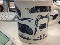 Great moustaches. Each number belongs to a famous celebrity listed on the bottom of the mug.