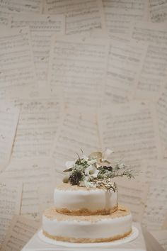 sheet music as a backdrop, photo by Katie Purnell http://ruffledblog.com/intimate-irish-wedding #wedding #backdrop #cakes