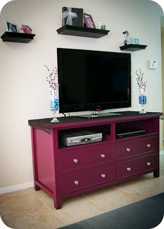 An old dresser into a TV stand. love the color