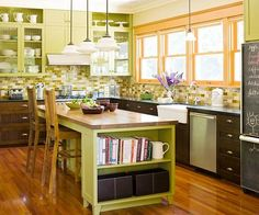 I love the warm green and orange color scheme.  I also love the abundance of storage and counter space.  Another great plus is the area on the end of the island which keeps cookbooks handy.
