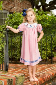 Hand smocked Bishop Gown with Lighthouse and Anchors from Crescent Moon Children.