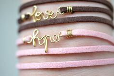 Leather bracelets with words.  Very cute.