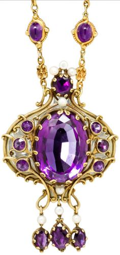 An art nouveau amethyst, enamel and pearl pendant, Marcus & Co., circa 1910.   suspending a scrolling pendant with fringe, centering an oval-cut amethyst surrounded by plique-a-jour enamel, accentuated by circular and oval-cut amethysts and white button pearls, within a chased and engraved mount highlighted throughout by scroll and bead motifs; suspended from an associated chain of double cabochon amethyst and scrolling links, pendant signed Marcus & Co. Via Bonhams.