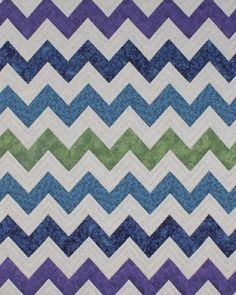 Jewel Waves Chevron QuiltThis modern chevron jewel toned quilt is a great gift for a teen or college student for their dorm. :)