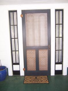 When we moved to our new home it had an ugly storm door.  While cleaning out one of the sheds I found the original screen door.  After lots of cleaning and a few coats of a period black paint and the addition of copper paint to the hinges and metal work on the bottom of the screen door, I put the old door back where it belonged.  I also found all of the old screens and plan on restoring them.  More pictures to follow of my lovely old girl.