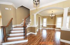 Love the archway and colors for an entry, but would want the stairway to be straight, and have an under stair reading bench before the archway.