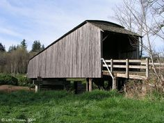 """The Grays River Covered Bridge  was built in 1905 and covered in 1908. It is 148 feet long and 14 feet wide, with two 9-foot """"porches"""" on the ends. Construction is """"Howe Truss framing"""". The bridge was restored in 1988-1989. The Wahkiakum County Historical Society states that this is the last covered bridge in the State of Washington which is still used by a public highway. The Grays River Covered Bridge was added to the National Register of Historic Places in 1971."""