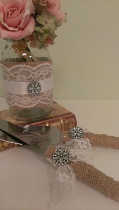 rustic wedding centerpiece burlap and lace wedding mason jar centerpiece burlap and brooch set of 6. $68.95, via Etsy.