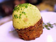 The Motherloaf Recipe - meatloaf (made in a muffin tin) topped with mashed potatoes   from foodnetwork