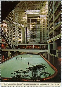 This postcard shows the Omni International Complex in Atlanta, Georgia in 1976, when it featured an ice skating rink. Visible on the left is part of the Omni's 205 foot escalator, which was listed in the Guinness Book of World Records as being the longest in the world at the time.