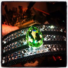 A sneak peak at the sparkling Spring line of Joxasa. Availability to be announced. A beautiful light green multifaceted Swarovski crystal positioned on top of Swarovski crystals and a black stingray cuff. Created in the USA and personally assembled by John Xavier Sanders of Joxasa.