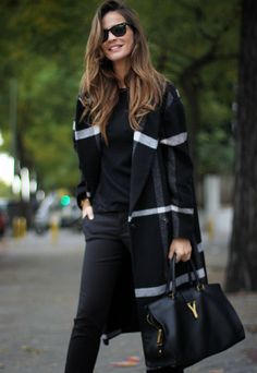 Long check coat and YSL bag. I have no idea who makes this coat but I wish I had it!