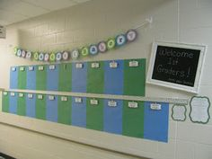 a frame and a painted piece of wood with chalkboard paint to make a hallway chalkboard. Update the title of hallway displays on the chalkboard! Also use ribbon to cover up the not so pretty cork strip in the middle of the display.