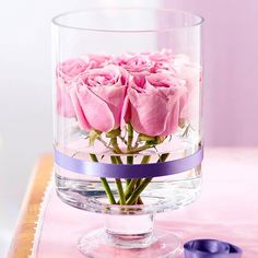 Use a glass hurricane for your Valentine's Day flower display! More bouquet ideas: http://www.bhg.com/holidays/valentines-day/decorating/valentines-day-flowers-centerpieces/?socsrc=bhgpin021314glasshurricaneflowerdisplay&page=9