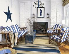 For this high-traffic beachfront home, the homeowner used semigloss paint, removable cushion covers, and wood floors for easy cleaning. Blue stripes and fun accents like the star and chandelier give the room a nautical feel.