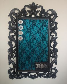 Use magnetic paint on a picture frame (not sure what colors it all comes in), cover with lace and BAM! Magnetic board to house makeup, or other items with a magnet
