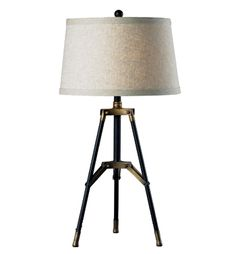 From the Elk Lighting's HGTV Home Collection, the weathered finish of the tripod base of this new lamp contrasts with the cream linen shade.
