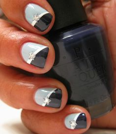 Black and a lighter blue with a star in the middle along with a white stripe color, nail designs, nail art designs, manicur, star, nail arts, blues, stripe, blue nails