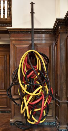 """Phyllida Barlow. Untitled; coils, 2011. Steel bracket, tape. Overall installed dimensions: 480 x 230 x 200cm / 189 x 901/2 x 783/4"""". Photo: Peter Mallet."""