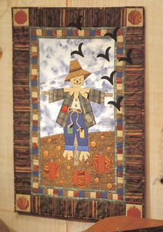 Patches: The Pumpkin Patch Protector paper-pieced wall quilt by Jaynette Huff.