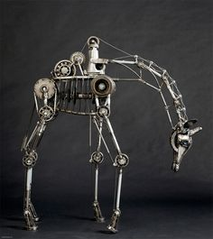Car parts = Giraffe sculpture by Andrew Chase