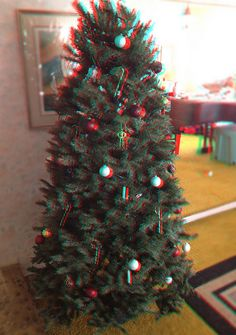 photo of our tree from Christmas as an experimental anaglyph 3D image, edited in Photoshop using two images taken about 3 inches apart. (red/cyan glasses required)