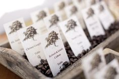 table names, rustic table, escort cards, coffee beans, place cards, purple wedding flowers, card displays, places, table seating