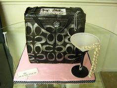 A Coach purse birthday cake. Covered in fondant and hand stenciled with silver luster dust thinned with alcohol. Please make for me Jess!!