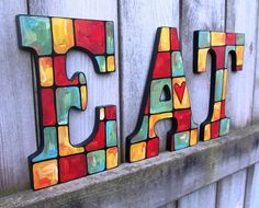 Hand-Painted Letters spelling EAT. $75.00, via Etsy.