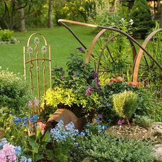 Instead of scrapping metal odds and ends, turn them into a whimsical garden design. More gardening trends: http://www.bhg.com/gardening/landscaping-projects/landscape-basics/whimsical-landscaping-design-ideas/?socsrc=bhgpin032013whimsicallandscaping