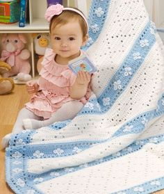 Lazy Daisy Blanket - Dress up this blanket with embroidered daisies. Perfect for playtime or naptime.