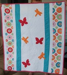 You can make springtime quilts that come together in no time with the Flutter and Flowers Springtime #Quilt #tutorial! This simple quilt involves only a few floral borders and several #dragonfly and #butterfly #appliques, giving it a fresh and modern look. Use an Accuquilt fabric cutter to make the butterfly and dragonfly appliques or create templates yourself using clip art or freehand drawings.