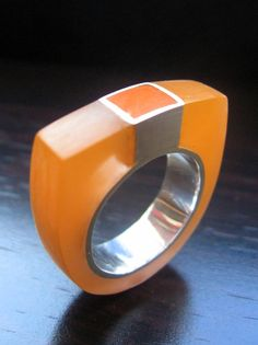 - Resin and silver ring.
