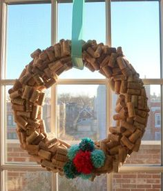 This Beautiful DIY Cork Wreath can be used after the holiday season's over! Time to start collecting corks!