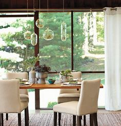 hanging air plant terrariums over the table, love this!