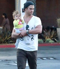 Chris Hemsworth with his baby India