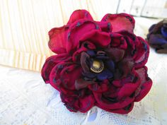 BEAUTIFUL handmade silk flower.  Idea for co-workers for Christmas gift - GREAT price.  on Etsy at SallywBloom  Burgundy Fabric Flower Clip w/ Purple and Brown Center. $10.00, via Etsy.