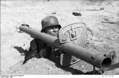 Panzerschreck or commonly known as The Stove Pipe or Tank Terror was A German Bazooka type weapon used by the German military during WWII.  It was a reusable weapon unlike its contemporary the Panzerphaust.