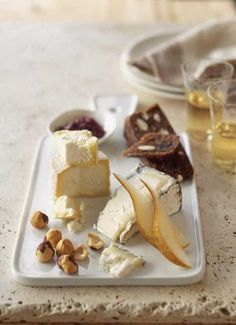 Winter Cheese Plate.   Humboldt fog, creamy goat's milk cheese, manchego, pear slices, raspberry jam, fig bar, hazelnuts.