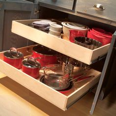 Make base cabinets more functional by building rollout trays for pots and pans. Family Handyman has the tutorial.