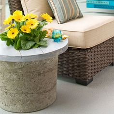 Hypertufa table with flowers in the top opening -- Lowes Creative Ideas - Love this. Want to make for front porch and patio