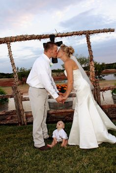 Cute wedding shot for couples who already have a little one.