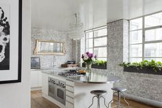 Amazing Matt Clayton kitchen. Stone, steel, gold, white, wood. Modern and ancient. Industrial and antique. WOW!