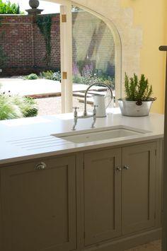 white silestone and sage cabinet